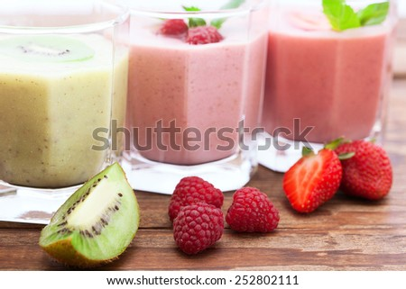 Drink smoothies summer strawberry, blackberry, raspberry on wooden table. Selective focus.