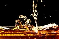Drink splash on black background