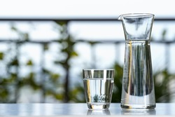 Drink water glass jug with glass on table at garden home