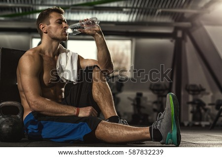 Shutterstock Drink water. Shirtless sportsman resting after training at the gym sitting on the floor drinking water with his eyes closed copyspase pleasure resting relax sports water lifestyle hydration vitality