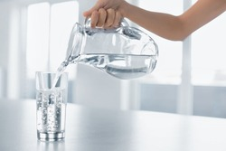 Drink Water. Woman's Hand Pouring Fresh Pure Water From Pitcher Into A Glass. Health And Diet Concept. Healthy Lifestyle. Healthcare And Beauty. Hydratation.