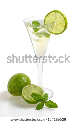 Drink with lime and mint in a champagne glass