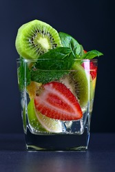 drink with ripe juicy fruits and peppermint leaves