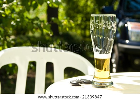 Drinking and Driving - Car keys and alcohol - stock photo
