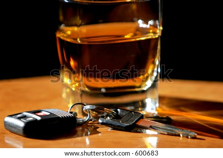 Drinking and Driving - Car keys and alcohol (shallow focus).