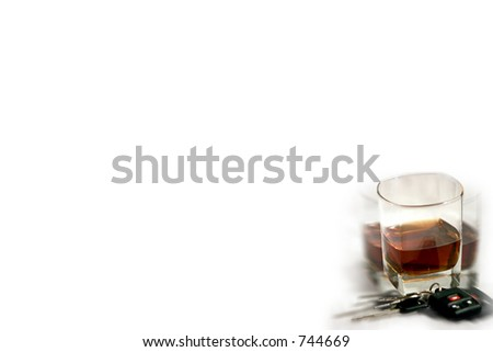 Drinking and driving image - glass and keys with blurred effect.