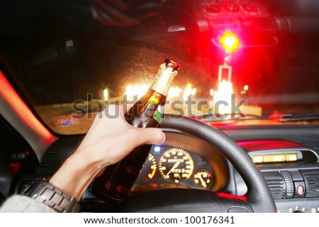 drinking beer while driving car