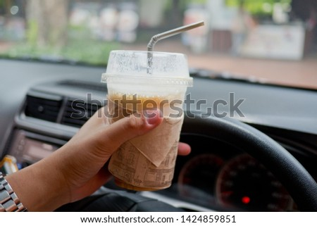 drinking coffee and driving, dangerous driving, hungry, do not drive, safe first  #1424859851