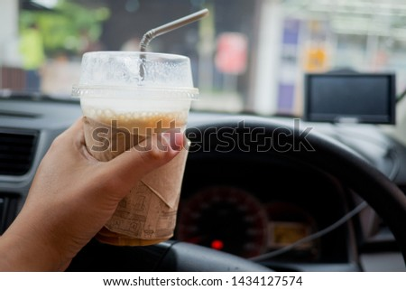 drinking coffee and driving, dangerous driving, hungry, do not drive, safe first  #1434127574