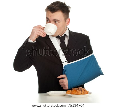 drinking coffee young businessman with broken hand wearing an arm brace, series