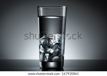 Drinking glass filled ice cube water top lighted
