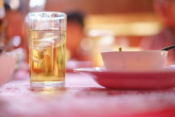 Drinking Thai whiskey mixed with soda water and ice in ceremony or event in Thailand