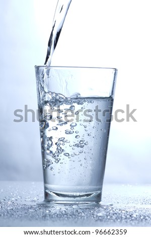 Drinking water pouring into glass.