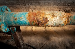 Drinking water supply system. Corrosion on the main pipe. Picture taken in Ukraine, Kiev region. Horizontal frame. Color image