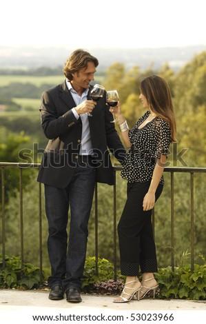 Drinking wine in a terrace - stock photo