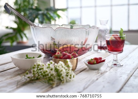 Drinks for a party on a rustic white table with flowers, mocktails berry punch cooler fruity cocktails with mint