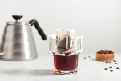 Drip coffee bag in a mug. Trends in brewing coffee at home.