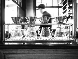 Drip coffee with blurred Barista background restaurant cafe