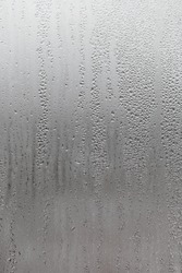 Dripping Condensation, Water Drops Background Rain drop Condensation Texture. Close up for misted glass with droplets of water draining down