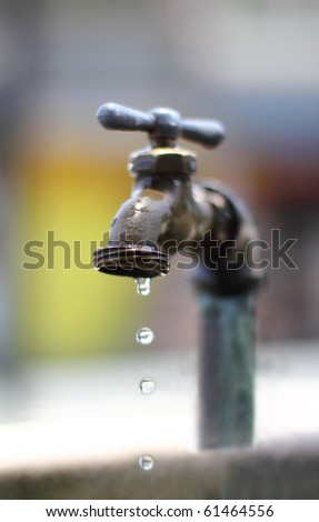 dripping water on an old faucet.narrow DOF