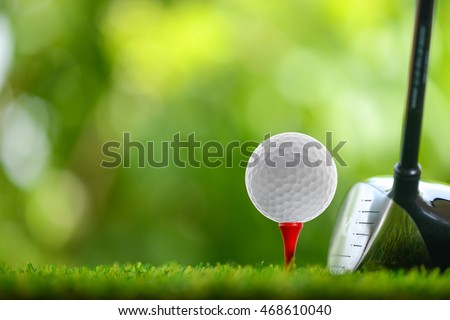 drive a golf ball on tee #468610040