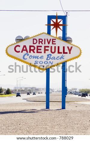 drive carefully (leaving las vegas sign)