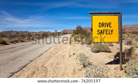 Drive Safely road sign at the South entrance to Joshua Tree National Park, California.
