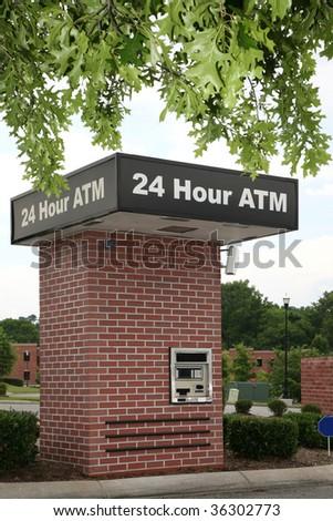 Drive through ATM in a suburban setting. - stock photo