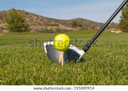 Driver and Golf Ball on the Tee
