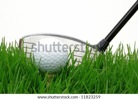 Driver behind a golf ball against at white background