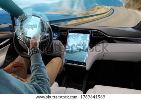 Driver controls an autonomous car using a smartphone