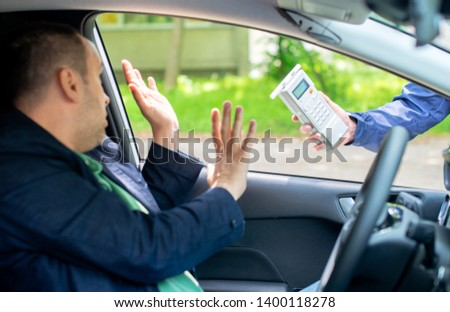 Driver due to being subject to test for alcohol content with use of breathalyzer