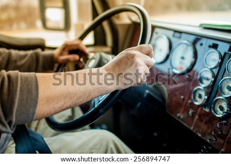 driver hands holding steering wheel