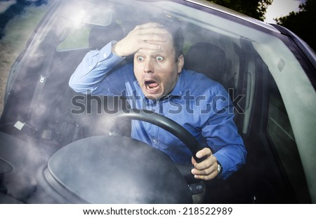 Driver in horror after car accident holding hand on his head