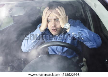 Driver in horror after car accident holding his head with hands