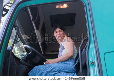 Driver of a truck in the driver's cab #1459666058