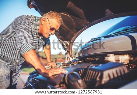 Driver on the road having problem with a car. Cars and transportation concept