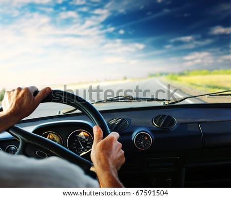 Driver\'s hands on steering wheel