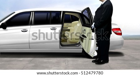 Driver waiting and standing next to the white limousine