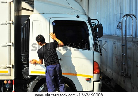 Driver wiping the truck  #1262660008