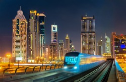 Driverless metro train with skyscrapers in the background - Dubai, the United Arab Emirates.