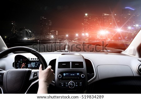 Drivers hands on the steering wheel inside of a car #519834289