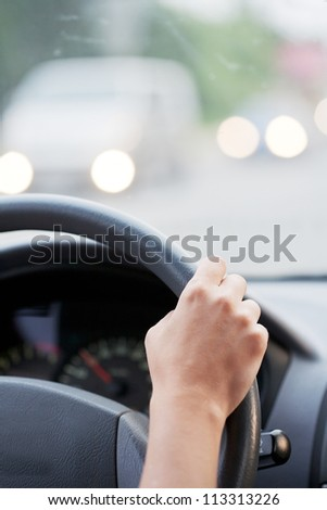 Drivers's hands on a stearing wheel of a car