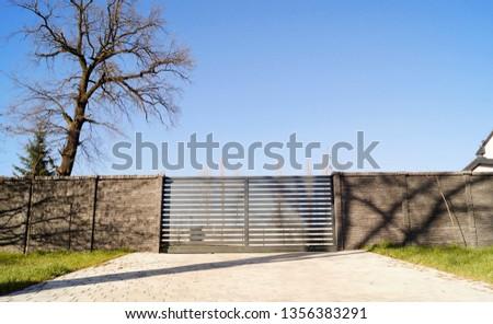 Driveway black security sliding gate #1356383291