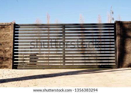 Driveway black security sliding gate #1356383294