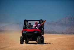 driving a buggy car through the desert. thrill safari adventures