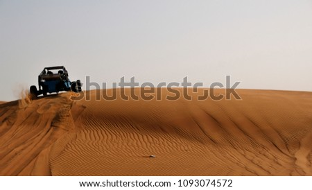 Driving a buggy in the Sweihan Desert in UAE