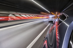 Driving a car at night trough tunnel