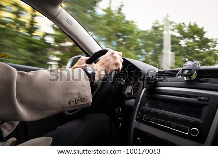 Driving a car (motion blur is used to convey movement)