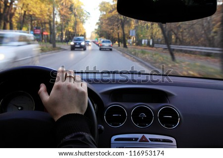 Driving a car on small road